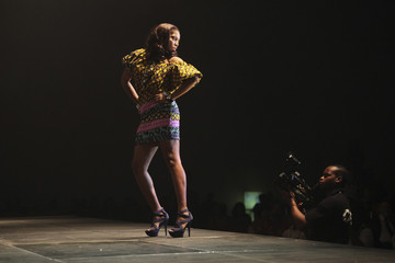 A contestant poses on the stage during the 24th edition of the Most Beautiful Girl in Nigeria(MGBN) beauty pageant in Lagos