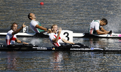 Hollstein and Ihle of Germany celebrate their win ahead of Kammerer and Vereckei of Hungary in men's 1000 meters K2 final at 2010 ICF Canoe Sprint World Championships in Poznan