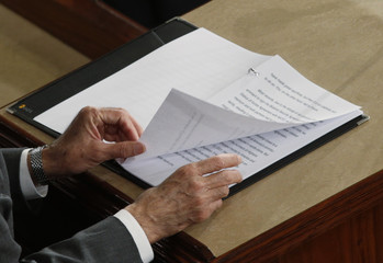 Afghan President Ghani turns a page of his text  during address to joint meeting of Congress at the U.S. Capitol in Washington
