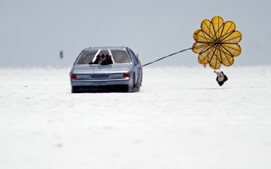 Jerry Strode deploys the chute on his Thunderbird race car during the first day of the 63rd annual Bonneville SpeedWeek on the Bonneville Salt Flats outside Wendover, Utah