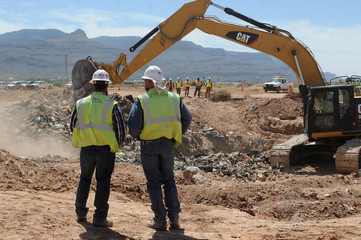Workers monitor progress at the old Alamogordo landfill in search of buried Atari games in Alamogordo