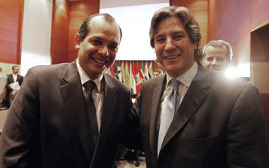 Peru's Economy Minister Castilla and Argentina's Economy Minister Boudou smile during a meeting of UNASUR ministers in Lima