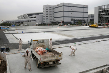 Workers are seen at the new Tokyo Metropolitan Central Wholesale Market under construction in the Toyosu district in Tokyo