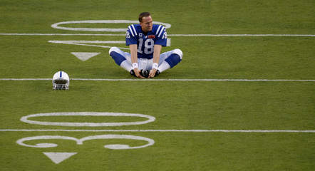 Indianapolis Colts' quarterback Peyton Manning participates in warmups prior to the the NFL's Super Bowl XLIV football game against the New Orleans Saints, in Miami, Florida