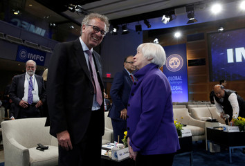 Federal Reserve Chair Janet Yellen (R) talks to Luxembourg Finance Minister Pierre Gramegna