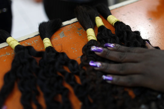 Hair extensions of a style called Megahair are displayed at a hair shop in a local market in Rio de Janeiro