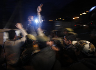 Indian police detain Kashmiri lawmaker Rashid during candle and torchlight demonstration outside office of UNMOGIP in Srinagar