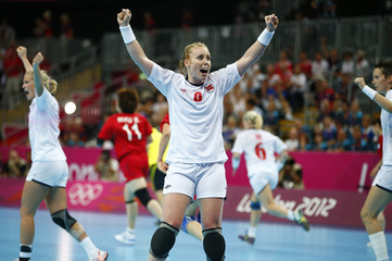 Norway's Karoline Dyhre Breivang celebrates victory against South Korea in their women's semi-final match at the Basketball Arena during the London 2012 Olympic Games