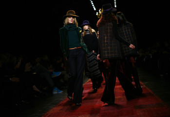 Models present creations from the Tommy Hilfiger Fall/Winter 2011 collection during New York Fashion Week