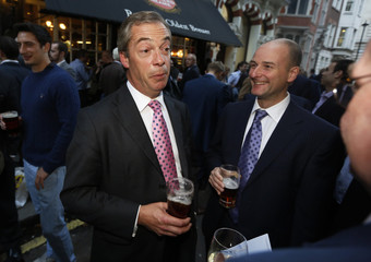 Leader of the UKIP Farage finishes the first day of the the annual party conference with a pint of beer at a nearby pub in London