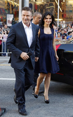 """Alec Baldwin and his wife Hilaria Thomas arrive for the screening of """"Rise of the Guardians"""" at the AFI FEST 2012 film festival in Hollywood"""