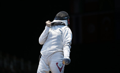 Lebanon's Shaito celebrates defeating Egypt's El Gammal during their women's Individual Foil round of 64 competition at the ExCel venue at the London 2012 Olympic Games