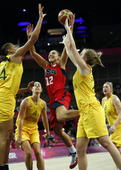 Taurasi of the U.S. goes between Australia's Cambage and Jackson during their women's basketball semifinal match at the North Greenwich Arena during the London 2012 Olympic Games