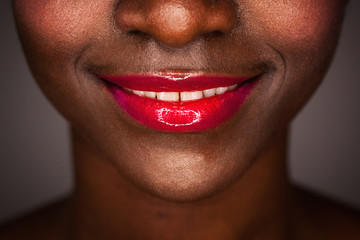 Sexy red lips of African-American woman in perfect close-up smile