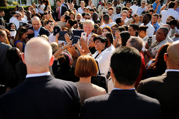Trump poses for photos after a campaign event with his employees at his Trump National Doral golf club in Miami, Florida