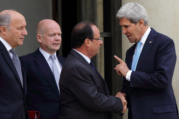 French President Hollande, US Secretary of State Kerry, British Foreign Secretary Hague and French Foreign Minister Fabius leave a meeting on Syria conflict at the Elysee Palace in Paris