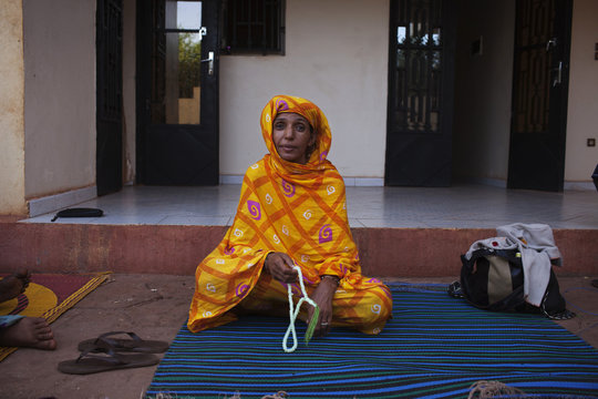 Assarid, an ethnic Tuareg woman who fled fighting in her home in Menaka, poses for a picture at her house in Bamako