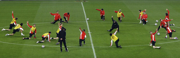 VfB Stuttgart's players stretch during a training session at Nou Camp Stadium in Barcelona