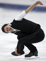 Chan of Canada performs during men's short program competition at ISU World Figure Skating Championships in Moscow