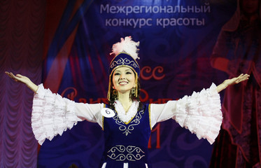 Aziza Sultonova of Kyrgyzstan, contestant of the 5th Miss Asia-Siberia amateur beauty contest, wears an ethnic dress as she competes in the final show in Krasnoyarsk