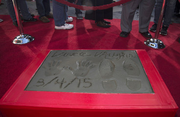 The handprints, footprints and signature of actor Vince Vaughn are pictured in cement in the forecourt of the TCL Chinese theatre in Hollywood