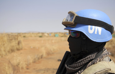 An Indonesian police officer, serving as part of the joint U.N./African Union UNAMID peacekeeping force in Sudan's Darfur region, patrols Zamzam refugee camp in North Darfur