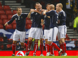 Scotland's Adam celebrates with his team mates after scoring a goal against Denmark during their international friendly soccer match in Glasgow, Scotland