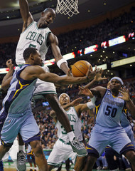 Memphis Grizzlies' Allen tires to pass the ball to Randolph around Boston Celtics' Garnett and Pierce during their NBA basketball game in Boston