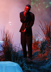 """Frank Ocean is bathed in red light as he performs """"Thinkin Bout You"""" during the 2012 MTV Video Music Awards in Los Angeles"""