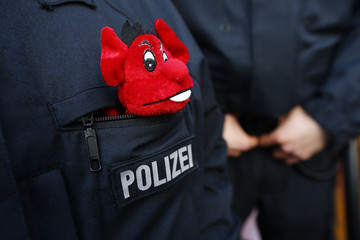 A police officer patrols during Rose Monday parade in Cologne