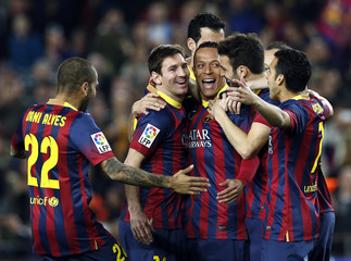 (L-R) Barcelona's Alves, Messi, Adriano, Fabregas and Pedro celebrate a goal against Rayo Vallecano during their Spanish first division soccer match in Barcelona