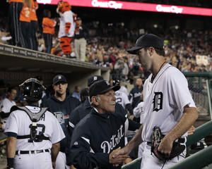 Tigers pitcher Verlander shakes hands with manager Leyland after the seventh inning against the Orioles in their MLB American League baseball game in Detroit