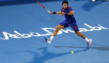Tsonga of France hits a return to Murray of Britain during the Mubadala World Tennis Championship in Abu Dhabi