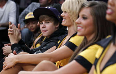 Justin Bieber sits amongst the Laker girls during the NBA basketball game between the Lakers and the Rockets in Los Angeles