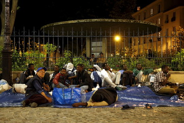 Migrants get ready to spend night in front of Saint-Bernard church in Paris