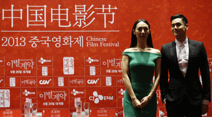 """Cast members Peng and Bai attend news conference to promote their movie """"A Wedding Invitation"""", the closing film of the Chinese Film Festival, in Seoul"""