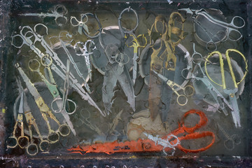 Art still life with a large number of different scissors.