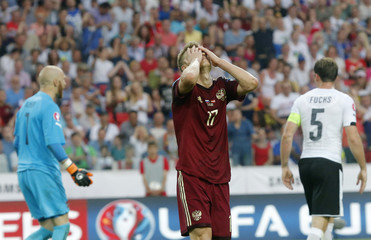 Russia's Shatov reacts to a missed shot against Austria during their Euro 2016 Group G qualifying soccer match at the Otkrytie Arena stadium in Moscow