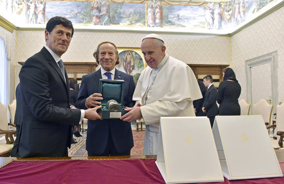 Pope Francis receives a gift from Captain Regents of the Republic of San Marino, Gian Franco Terenzi and Guerrino Zanotti, during a meeting at the Vatican