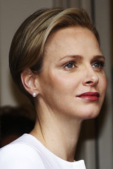 Princess Charlene of Monaco attends a gift-giving event for the elderly at the Red Cross headquarters in Monte Carlo