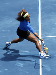 Serena Williams of the U.S. returns the ball to Lucie Hradecka of Czech Republic during their women's semi-final match in Madrid