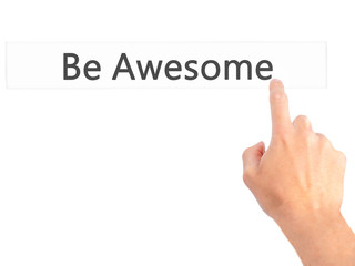 Be Awesome - Hand pressing a button on blurred background concept on visual screen.