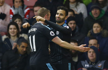 West Bromwich Albion's Hal Robson-Kanu celebrates scoring their second goal with Chris Brunt