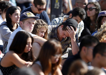 Students gather during a memorial service in honor of the victims of the Isla Vista rampage in Santa Barbara