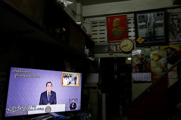 Thailand Prime Minister Prayuth Chan-ocha is seen on a TV during his weekly broadcast in Bangkok