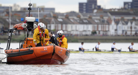 The man who jumped in to the water to halt the Oxford vs Cambridge boat race is taken away by rescue personnel on the River Thames in west London
