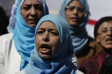 Women demonstrate against prolonged political dialogue outside a hotel hosting U.N.-sponsored negotiations on a political settlement for Yemen's crisis in Sanaa