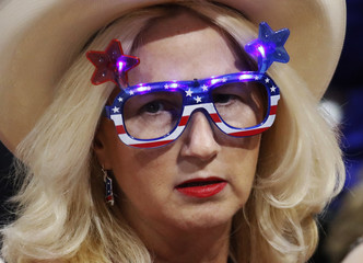 A delegate with illuminated glasses waits for the session to begin at the Republican National Convention in Cleveland