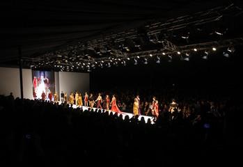Models present a creation by designer Erol Albayrak during Istanbul Fashion Week