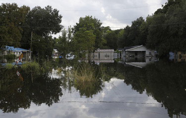 Floodwaters cover streets of a residential area in Sorrento, Louisiana